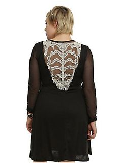 "<p>Black dress with sheer long sleeves, a sweetheart neckline and ivory crocheted rib cage design on the back.</p>  <p>Size 0: bust 40-42""<br /> Size 1: bust 42-44""<br /> Size 2: bust 46-48""<br /> Size 3: bust 50-54""<br /> Size 4: bust 54-58""<br /> Size 5: bust 58-62""<br /> Size 6: bust 64-68""</p>  <ul> 	<li>87% polyester; 10% rayon; 3% spandex</li> 	<li>Contrast: 100% nylon</li> 	<li>Hand wash cold; dry flat</li> 	<li>Made in USA</li> </ul>"