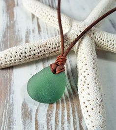 Hand-crafted seaglass necklaces made for Skipjack using 100 percent genuine beach-combed seaglass from the southwest coast of Scotland! We've selected seaglass in shades of agua and seafoam, (our personal favorites) and naturally frosted to produce these simple but elegant necklaces. Hand knotted leather that is self adjusting for desirable length.