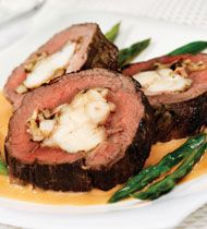 Lobster Stuffed Beef Tenderloin with Lobster Sauce. My mom makes a version of this at Christmas sometimes. Incredible!