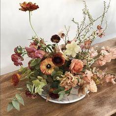 Tinge Floral | Flower Recipe: autumn eucalyptus, spirea, brown Japanese sweet pea, brown lisianthus, Japanese ranunculus, coral ranunculus, rust ranunculus, hellebore, and hyacinth.