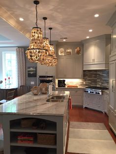 Beautiful kitchen designed by Low Country Wallcoverings in Savannah Georgia. Countertops and tile provided by Distinctive Granite serving Georgia, South Carolina, and the surrounding areas.