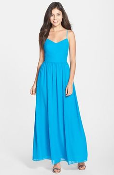 Adelyn Rae Chiffon Fit & Flare Maxi Dress at Nordstrom.com. A fitted spaghetti-strap bodice and tasteful side cutouts nicely balance the long, voluminous skirt of this sun-beckoning maxi dress.
