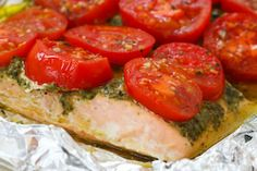 Salmon, pesto & tomatoes - deeelish and oh so easy!