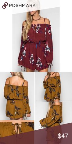 """New Arrival Walk At Sunset Romper What a perfect day you will have all while living out your dreams in this beautiful and lovely """"Walk at Sunset"""" romper! What more details?! Long sleeve, floral print, off the shoulder with shoulder straps! It's perfect!  S: 70% cotton / 30% polyester  L: 100% polyester woven romper  Model is 5'9"""" and wearing a size small. Boutique Pants Jumpsuits & Rompers"""