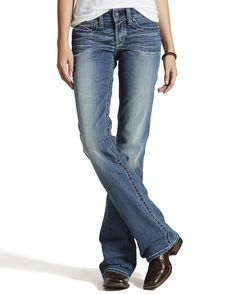With an athletic mid-rise waist and performance stretch denim, Ariat's Real Riding Jeans offers style and comfort that fits to perfection. These Rainstorm jeans have been designed wear-tested by riders and thoughtfully engineered. Contrasting stitching adds trendy flavor to this choice item of clothing. Boot cut finishes allows for easy wearing over your favorite footwear. A zip fly with button closure makes for secure fitting. A classic 5-pocket design, with stitch detailing on flat back…