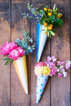 Floral Wall Cones Wedding Decorations Ideas. Easy to make in your colors. They can make such a statement. Make them different sizes to add more appeal. See our website Vintage Emporium Rentals .com for more tips and ideas from our team..