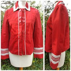 """Red jacket with beige grosgrain trim. Looks great against a dark denim jean and patent leather flats. Stylish and trendy! 100% cotton Made in Poland Pit to pit 17"""" Length 21"""" Sleeve 22.5"""" Cuff 5"""" Measurements are approximate"""