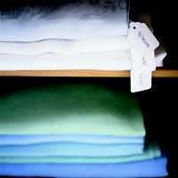 If you have a well-stocked linen closet, use this trick to keep differently sized tablecloths and sheet sets organized. Next time you're at the office supply store pick up a package of paper tags. Write the information about each piece on the tag (for tablecloths: the measurement and the shape; for sheet sets: the size bed it fits), then store […]