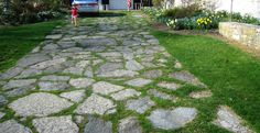 I really like this kind of driveway. i would just use different color stones and have it outlined more from the actual grass lawn instead of all as one piece.