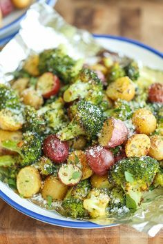 Garlic Parmesan Broccoli and Potatoes in Foil - The easiest, flavor-packed side dish EVER! Wrap everything in foil, toss in your seasonings and you're set!