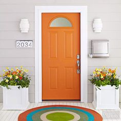 These homeowners repeated the citrusy tones as flowers in door-framing planters.