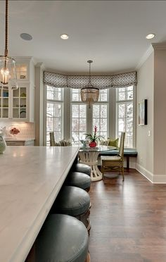 Small Breakfast Nook Glass Top Round Kitchen Table Trendy Family Home Breakfast Nook Curtains, Small Breakfast Nooks, Glass Kitchen Tables, Small Round Kitchen Table, Bay Window Treatments, Window Coverings, White Marble Kitchen, Luxury Interior Design, Beautiful Kitchens