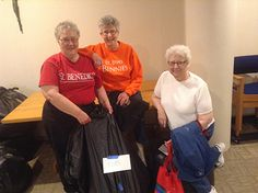 We're de-cluttering for Lent. Sisters Philip Zimmer, Georganne Burr and Michon Lanners bagging clothes to share with needy. Photo: Thomasette Scheeler, OSB people.