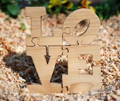 Love Puzzle Made of Wood - Love is All You Need.