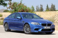 2012 BMW M5 - blue - front three-quarter view    For those of you looking to snag a brand-new BMW M5 or M6, good news has arrived. The German super sedan and two-door have finally rolled in to U.S. dealerships. (Given how long we've been talking about these cars, you could be forgiven for thinking they've been on sale in the States for ages.)