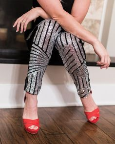 The party pant! This pant features a fully sequined front with black and silver, and a solid black back with zipper closure. A perfect way to be festive and warm on cool nights! glitter pants, sequined pants