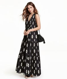 Check this out! Sleeveless maxi dress in airy, woven cotton fabric with a printed pattern. Small stand-up collar with ruffle trim, opening at front with twisted ties with tassels at ends, and full, tiered skirt. Unlined. - Visit hm.com to see more.