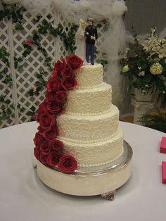 Marine Wedding Cake  Beautiful roses cascade down an elegant cake