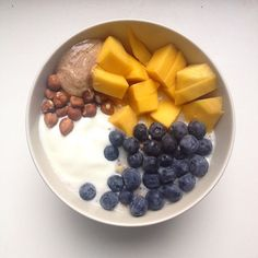 All the nuts: coconut milk porridge with chia seeds topped with mango, blueberries, natural yogurt, whole hazelnuts and almond butter #porridge #oatmeal #coconutmilk #chiaseeds #mango #blueberries #almondbutter #wholehazelnuts #breakfast #brekkie #foodie #mostimportantmealoftheday #healthy #goodstart
