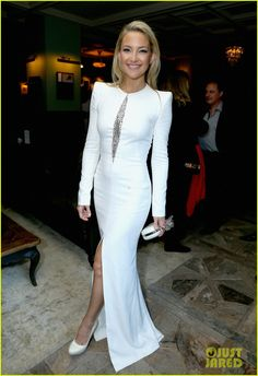 Kate Hudson is wearing a dress, shoes, and bag by Alexander McQueen with Tiffany & Co. jewelry.