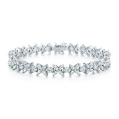 Matching Tiffany & Co. Wedding bracelet. Victoria alternating bracelet of diamonds in platinum..