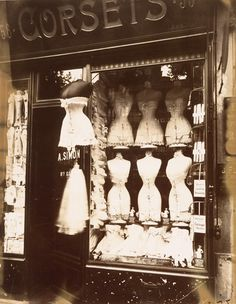 """Eugène Atget, Boulevard de Strasbourg, Corsets, Paris, 1912. """"Oysters and a glass of wine, a corner café, the Sunday bird market on the Île de la Cité, a lover's stolen kiss….."""""""