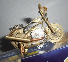 Collectible Steampunk watch parts motorcycle art piece  home décor. My109
