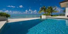 Sun Salutations Villa - infinity pool and private sandy beach overlooking the North Sound bay