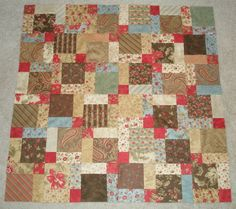 I read about the coolest technique over at Quilts & ATCs -- disappearing nine patch blocks. You make regular nine patch blocks, then cut them in half both ways to make blocks that look much more complicated than they are....