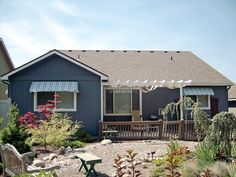 Shown on this desert home in Arizona are NuImage Awnings' Series 3700 Fabric…