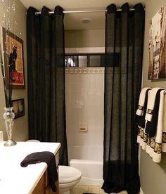 Floor to ceiling shower curtains...makes a small bathroom feel luxurious.
