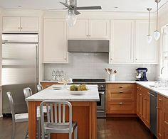 Combining wood base cabinets with white upper cabinets instills this kitchen with an aesthetic that is light, bright, and uncluttered: http://www.bhg.com/kitchen/color-schemes/neutrals/beautiful-kitchens-with-natural-colors/?socsrc=bhgpin051814lightbrightanduncluttered&page=8