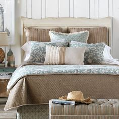 Loving the neutral color palette of blues and browns in this serene coastal bedroom. Click to bring the whole look home on Wayfair.
