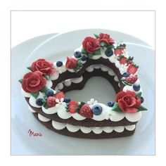 These are two decorated cookies! A cookie and royal icing version of the Cream Tart. The cookies measure 4×4 in/ 10×10 cm. Roses, strawberries, blueberries and little white flowers are royal icing transfers. Filling is royal icing. Inspired by Adi...