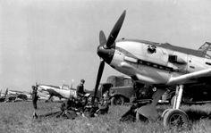 """Four Messerschmitt Me 109 E of Jagdgeschwader 51 """"Mölders"""" (IV./JG 51) on an airfield in France, August 1940"""