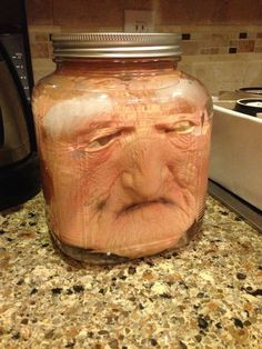 Put a costume mask in a jar then added water! Plan on putting a glow stick or submersible LED light in the jar for effect.