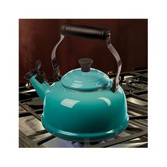 I'd love a pretty, whistling tea kettle to wake me up in the morning. Le Creuset 1.8-qt. Whistling Tea Kettle