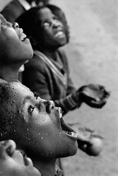 School children in rain storm. Lesotho, South Africa ~ by Chris Steele-Perkins. Innocence of children Magnum Photos, Foto Portrait, Love Rain, Foto Art, Ansel Adams, Jolie Photo, Dancing In The Rain, People Of The World, Rainy Days