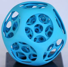 George W. Hart - One of my favorite four-dimensional forms is the 120-cell.    This baby-blue ball is based on the edges of a perspective transformation of the 120-cell.   Its 720 pentagons are rounded to circles and ellipses to give it a softer character (and more engineering strength).