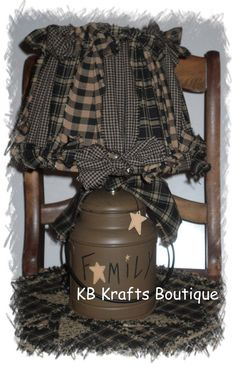 Milk Can Lamp with Rag Lamp Shade by KBKraftsBoutique on Etsy, $57.00  The shade is a bit much for me but done in one or two fabrics with a little more simple style would be good.