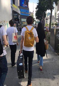 Tom Campfire wearing our mustard boardwear backpack in Seoul, South Korea.