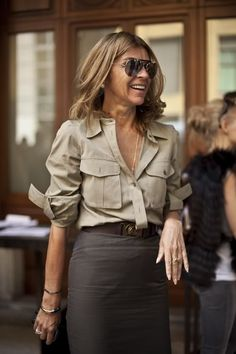 Carine Roitfeld Style - She was the ex director of Vogue Paris from 2001 to 2010. She wore a military shirt with a brown pencil skirt.  #carineroitfeld #celebritystyle