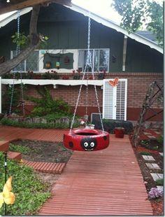 ladybug-painted tire swing 2