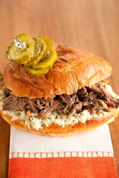 Paula deen Slow Cooker Pulled Pickled Beef Sandwiches 60  1(24 oz.) jar Dill Pickle Spears with liquid  2 lb. chuck roast  pepper to taste  2 cups prepared sweet cole slaw  8 sandwich buns, soft