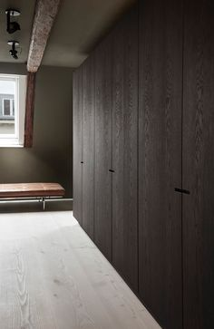 The striking wardrobe section from our project at Store Kongensgade, Copenhagen. Wardrobe Behind Bed, Built In Wardrobe, Carpentry And Joinery, Desks For Small Spaces, Dressing Room Design, Bungalow House Design, Futuristic Furniture, Closet Designs, Küchen Design