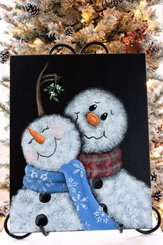 This is a painting of an adorable snowman couple meeting under the mistletoe. Mr. Snowman bashfully dangles the mistletoe over his sweeties head hoping for a little kiss. The painting is done on an 11x14 inch canvas. The sides have been painted so no framing is necessary. The painting has been sealed for lasting protection. It may be displayed on an easel or hung directly on the wall. *Note: The easel is not included.