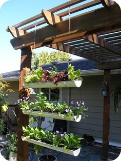 Garden Decor - DIY Gutter Gardens. Repurpose old shutters into gardens. Make an artistic statement by hanging them from your pergola