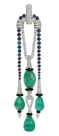 A FINE ART DECO GEM-SET PENDANT, BY CARTIER  The central pendant designed as two fluted emerald beads with pavé-set diamond surmount and onyx rondelle detail flanked by similar pendants suspended from a graduated line of cabochon sapphires to the pavé-set diamond suspension loop, circa 1925, 12.0 cm long