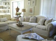 white romantic living room with rugs