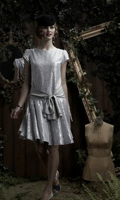 Shabby Apple silver silk dropwaist dress.  Oh, how I want this.  Like the dresses of my childhood.
